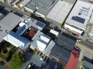 Main 50kWp solar array over carpark with additional arrays on other rooftops. Further solar has subsequently been added.